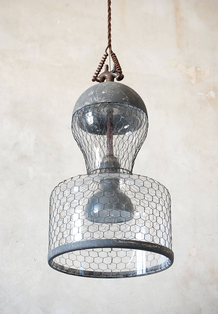 Suspended glass street lamp