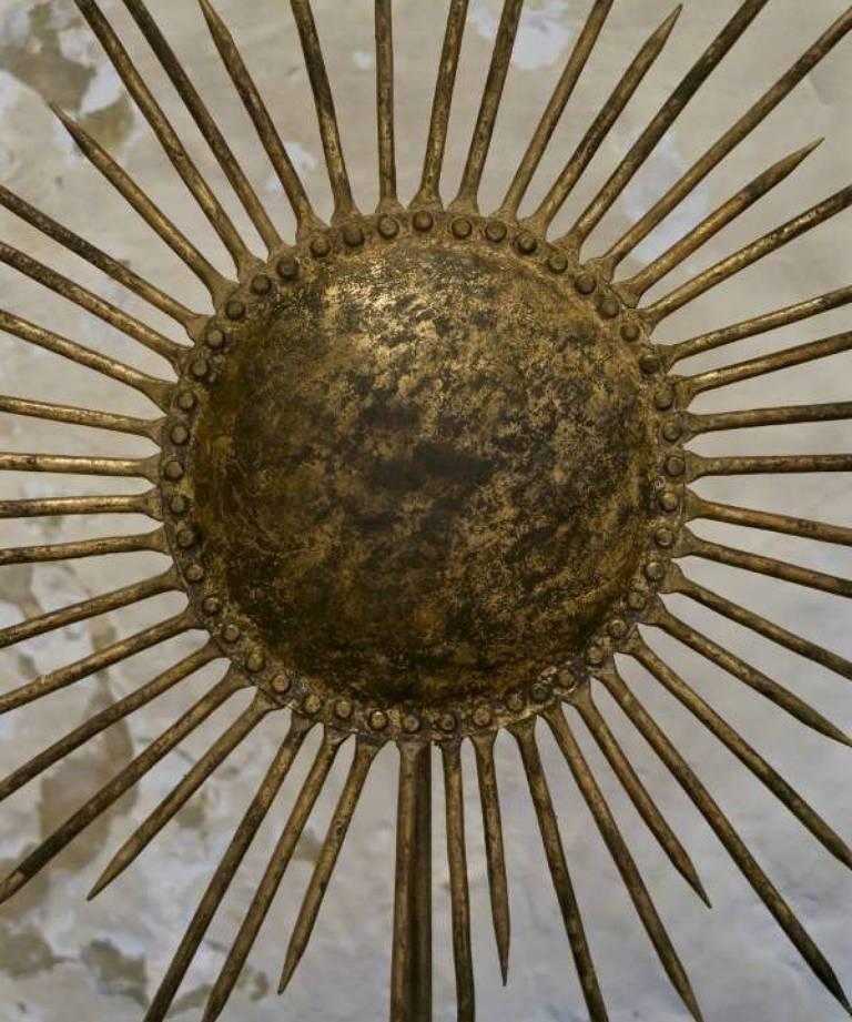 Sunburst on plinth