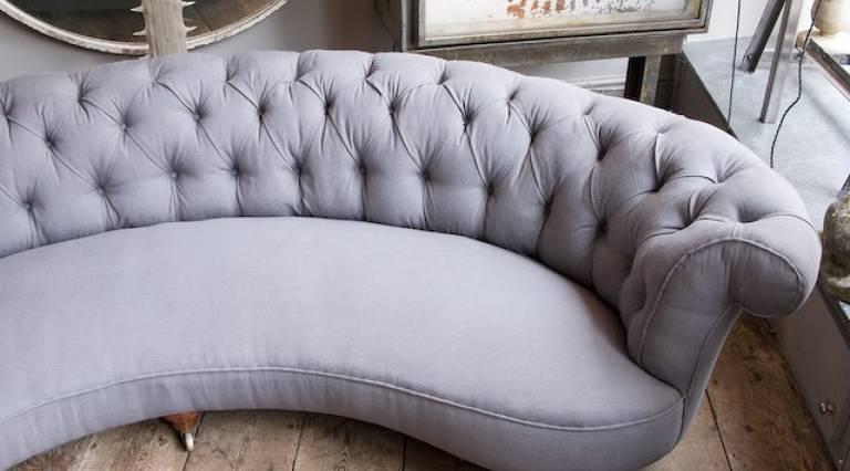 Curved grey sofa