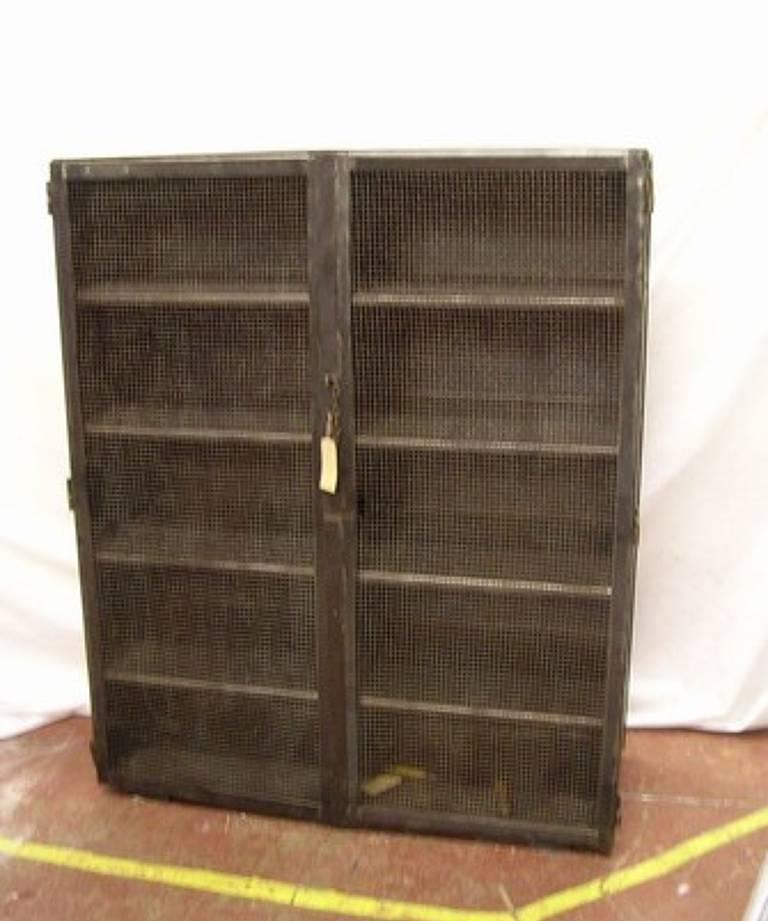 Steel cupboard with mesh doors