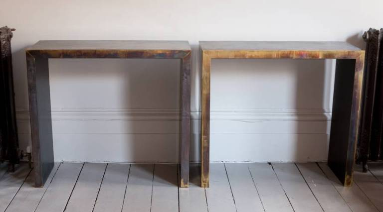 Pair of brass covered console tables