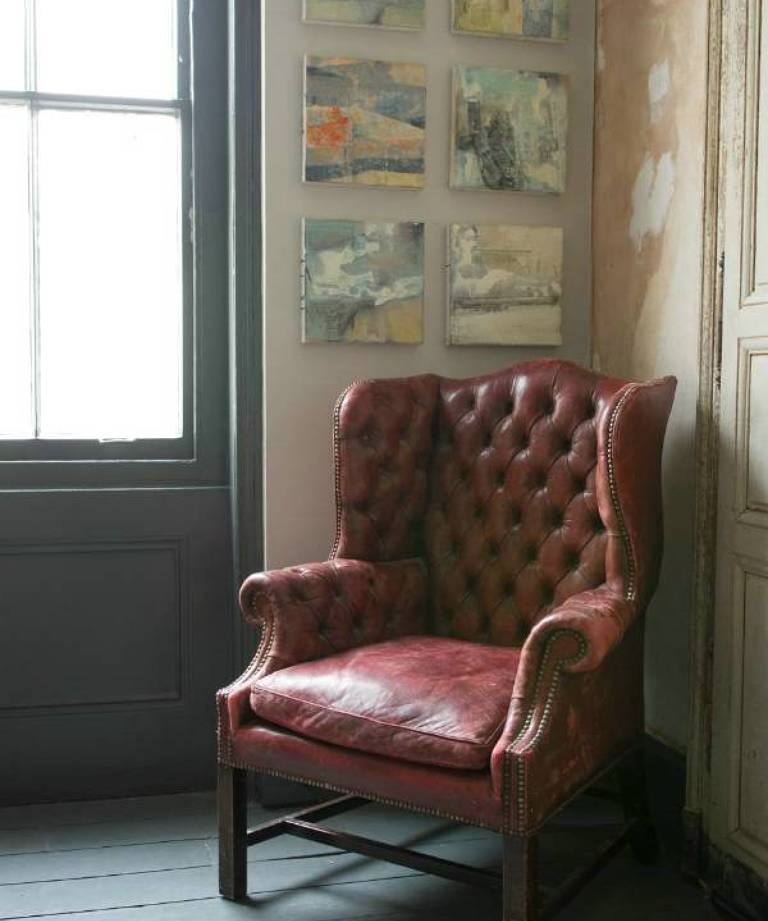 Red leather wingback armchair