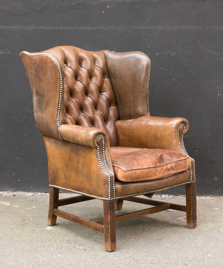Leather wing back arm chair