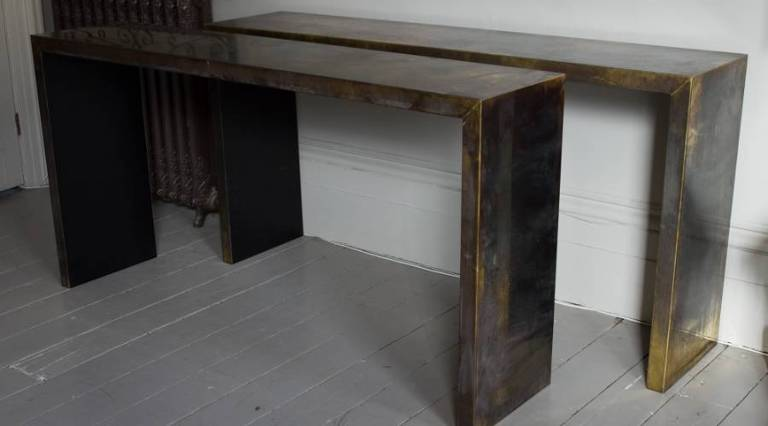 Pair of brass console tables