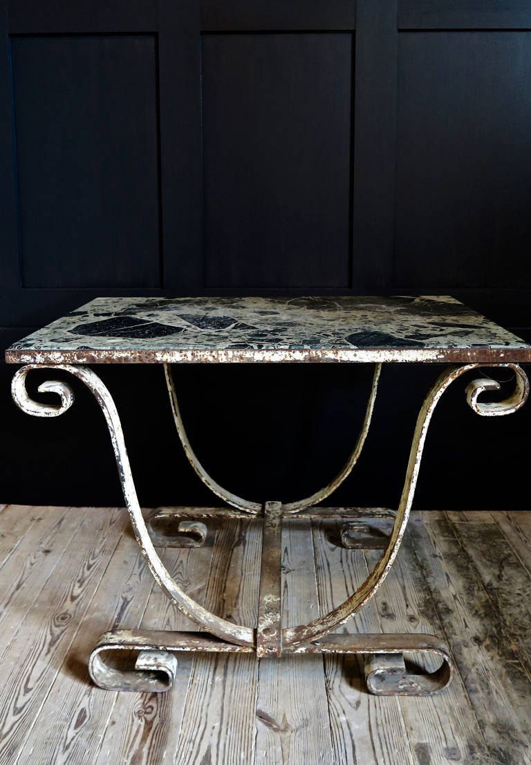Iron table with marble top, circa 1920