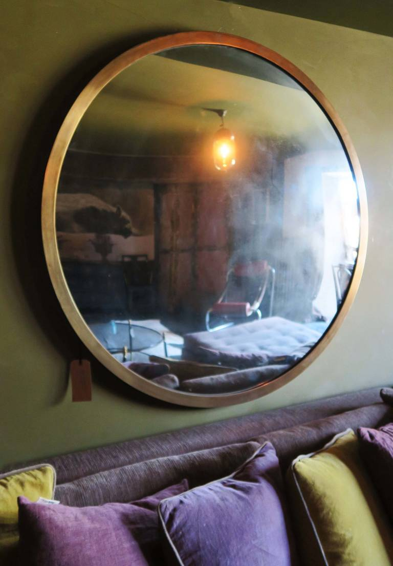 Convex mirror, circa 1920 with brass frame